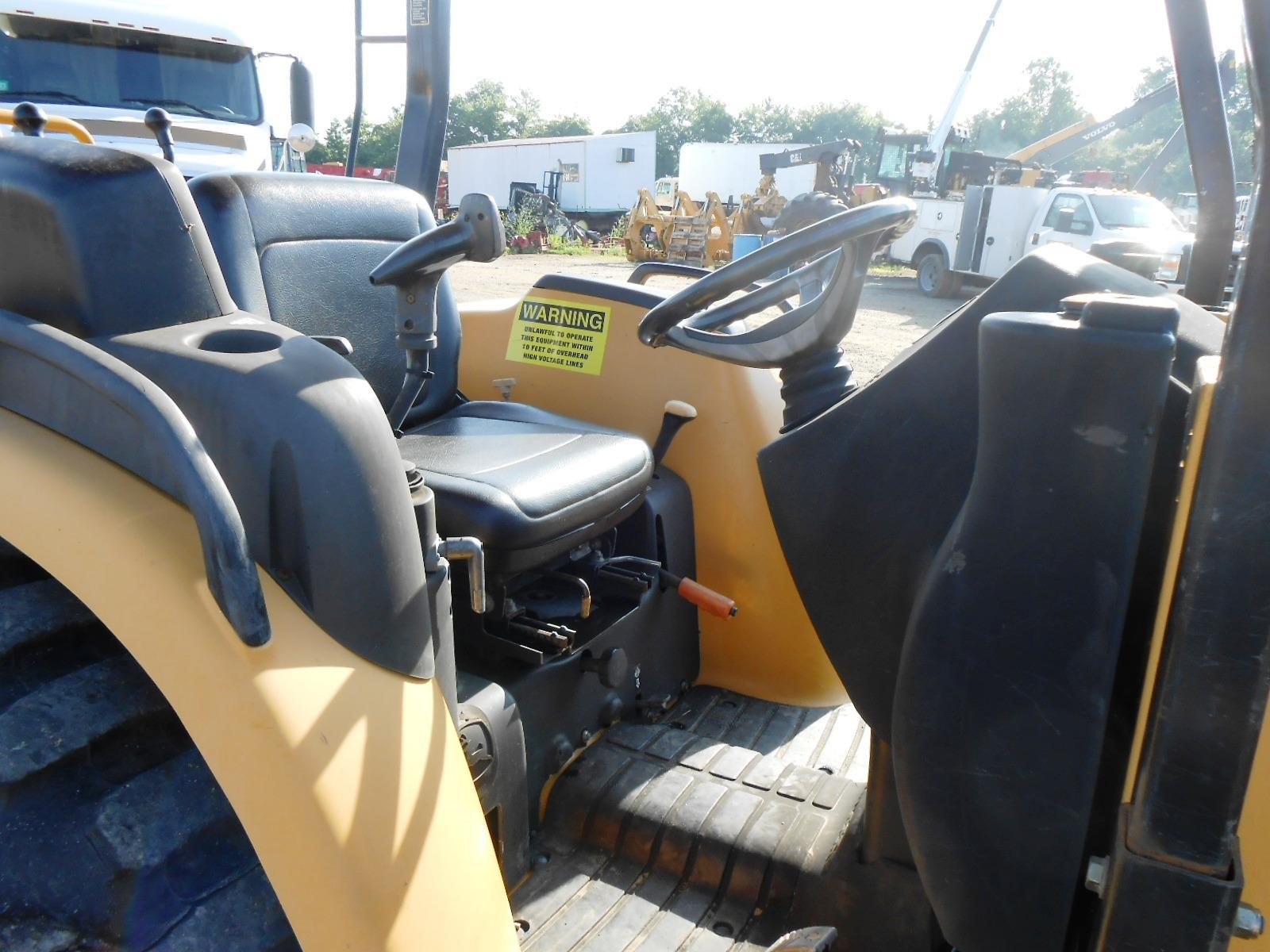 Detail photo of 2004 John Deere 110 from Construction Equipment Guide
