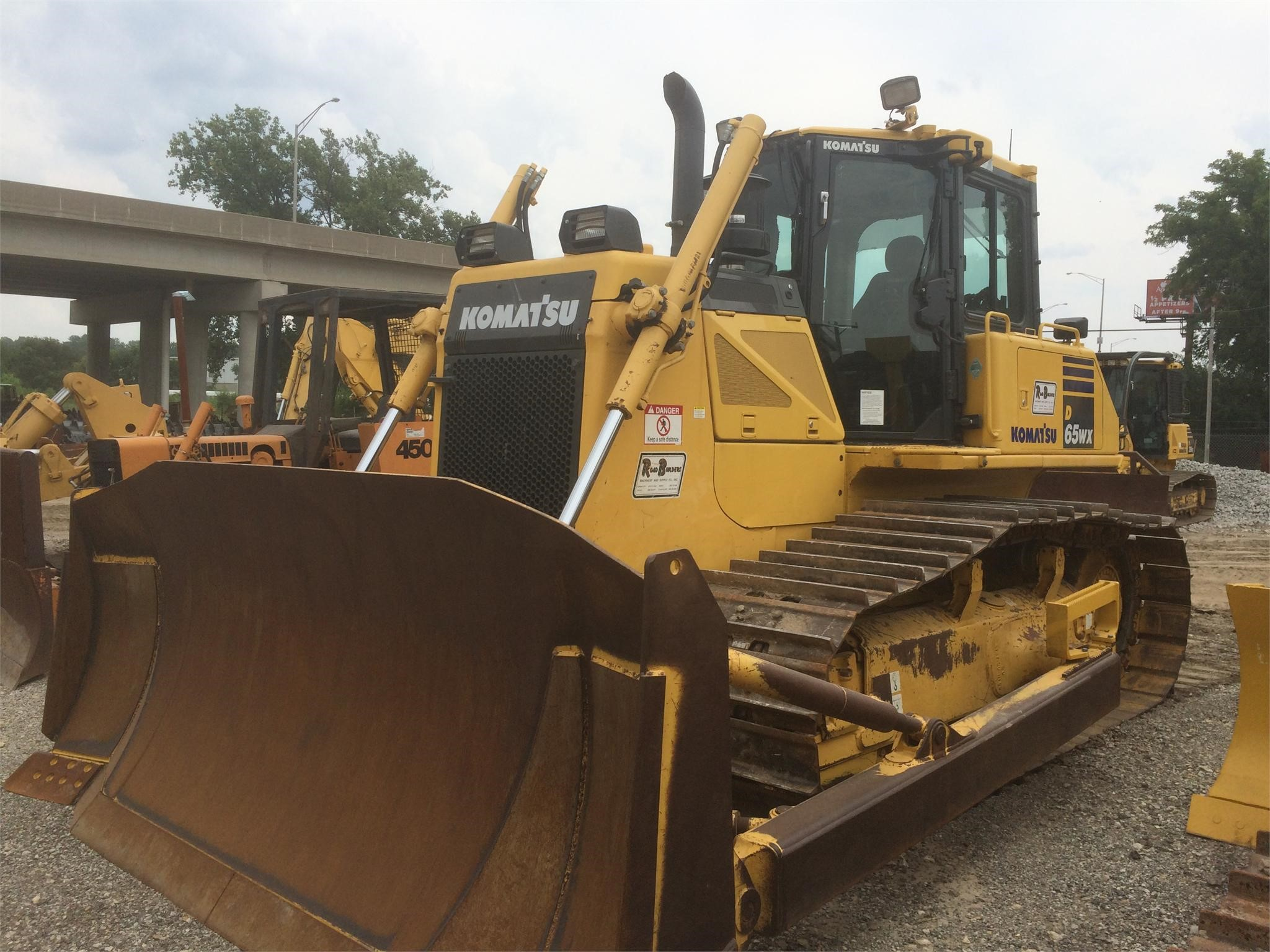 Detail photo of 2012 Komatsu D65WX-17 from Construction Equipment Guide