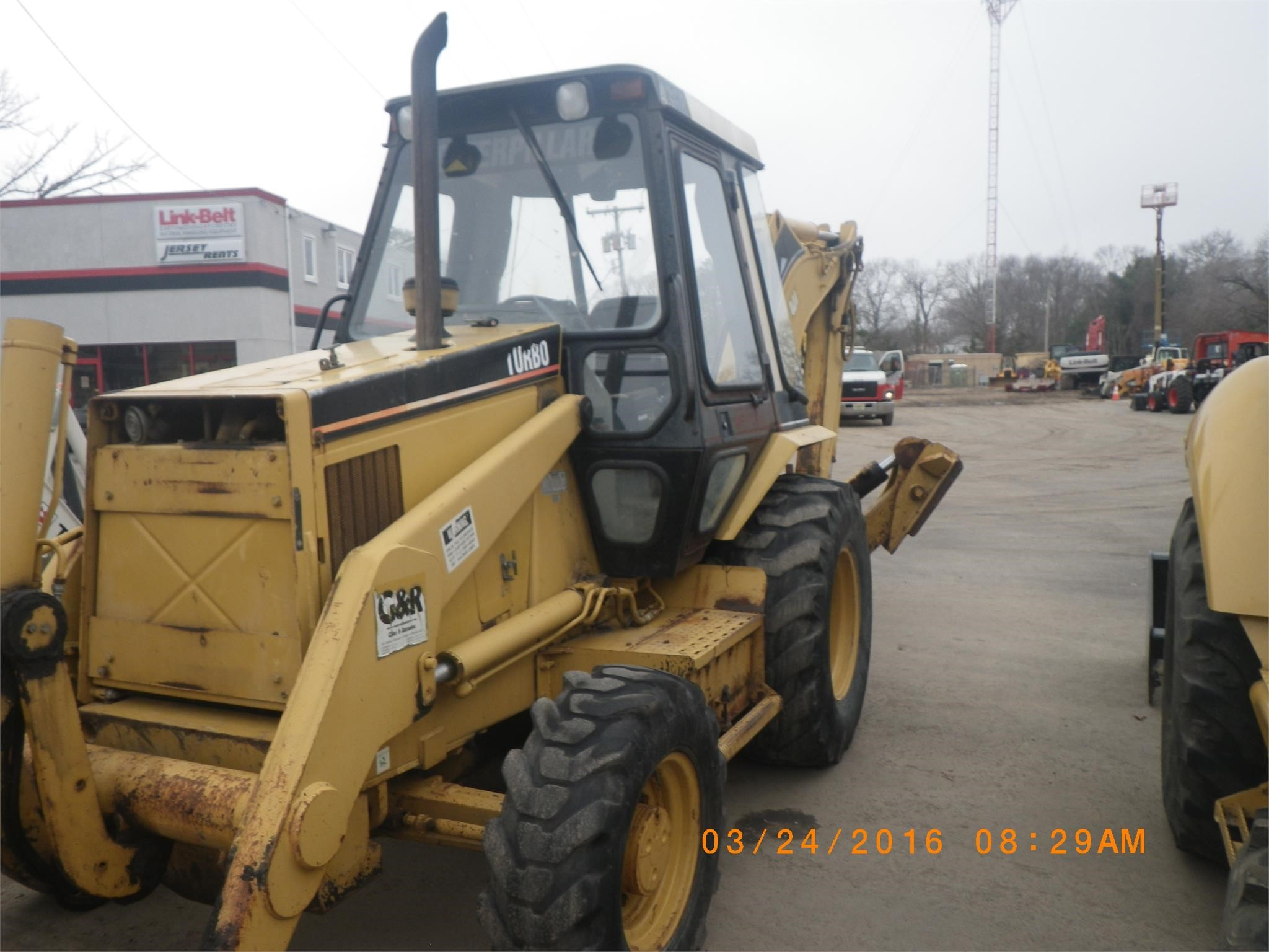 Detail photo of 1996 Caterpillar 436B from Construction Equipment Guide
