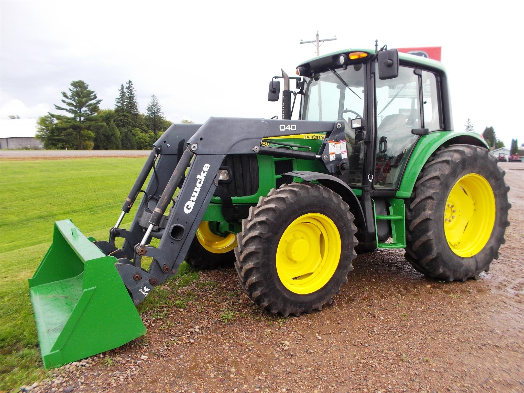 Detail photo of 2011 John Deere 6430 from Construction Equipment Guide