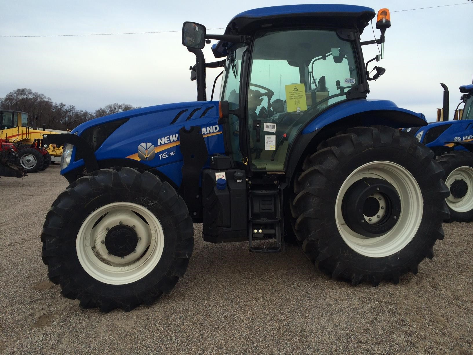 Detail photo of 2017 New Holland T6.145 from Construction Equipment Guide