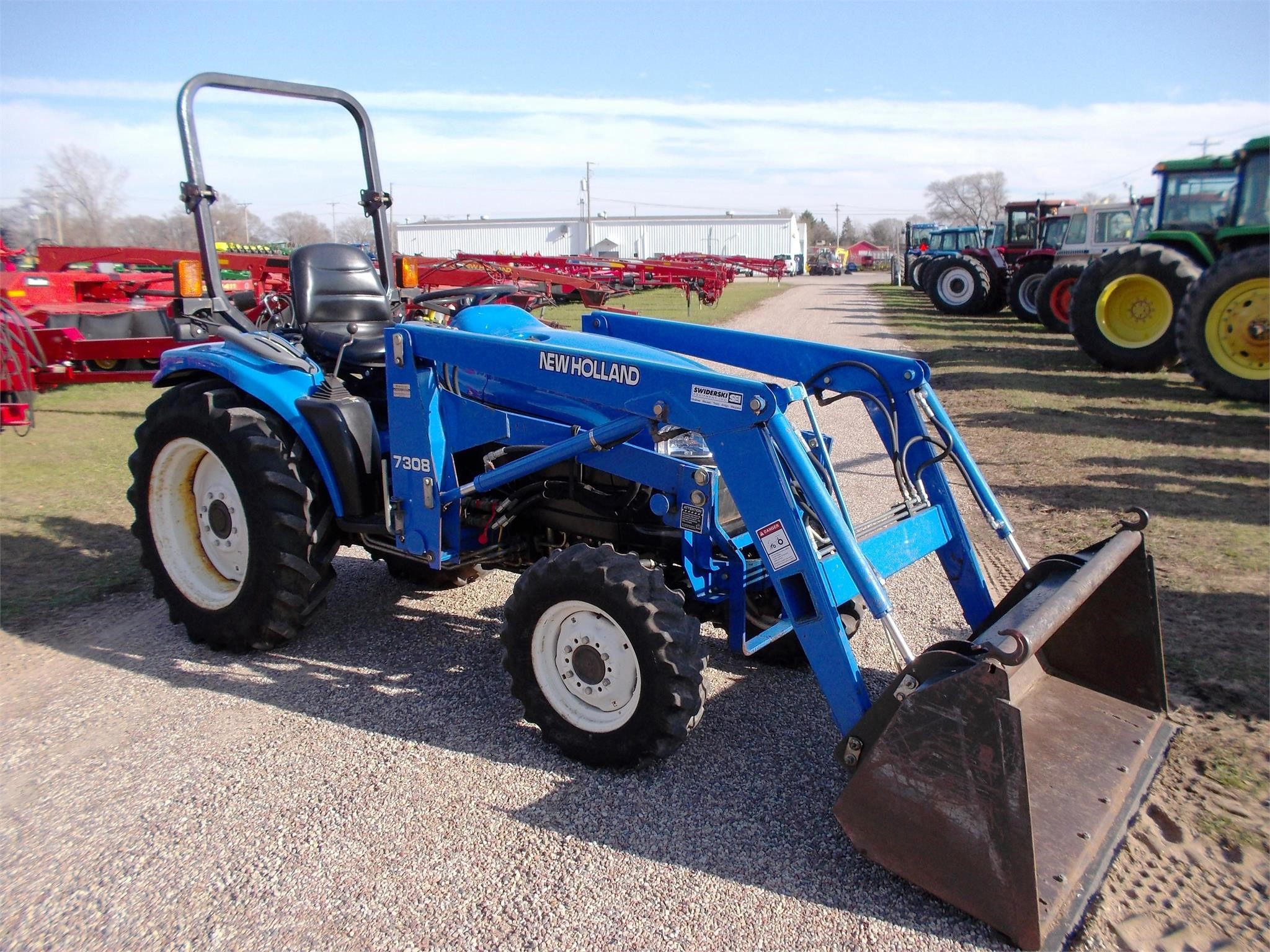 Detail photo of 1999 New Holland TC33D from Construction Equipment Guide