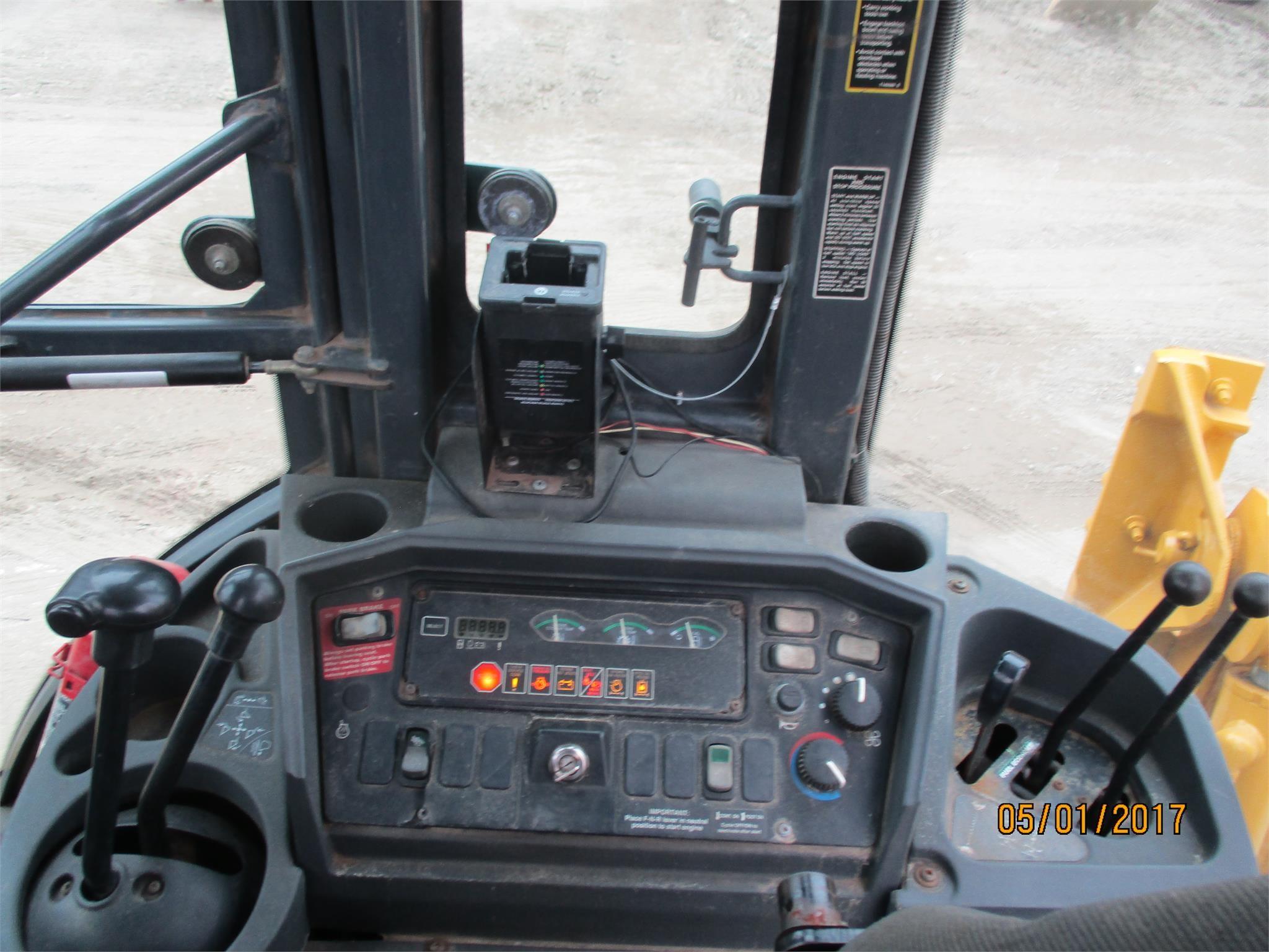 Detail photo of 2002 John Deere 310G from Construction Equipment Guide