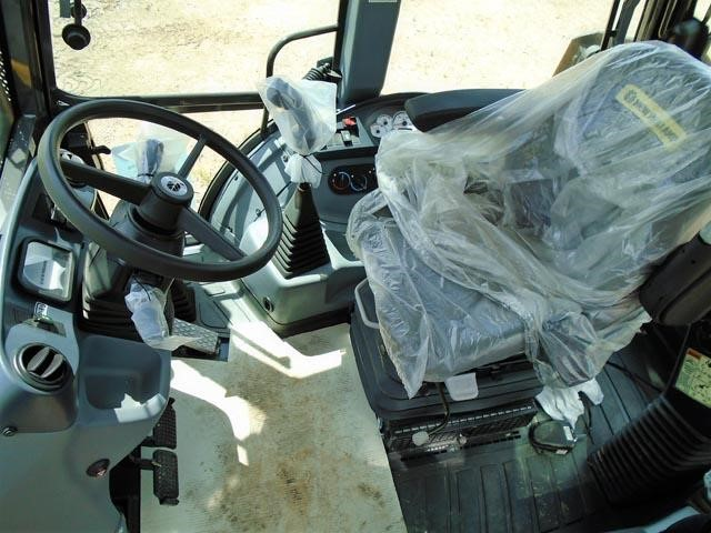 Detail photo of 2015 New Holland B95C TC from Construction Equipment Guide
