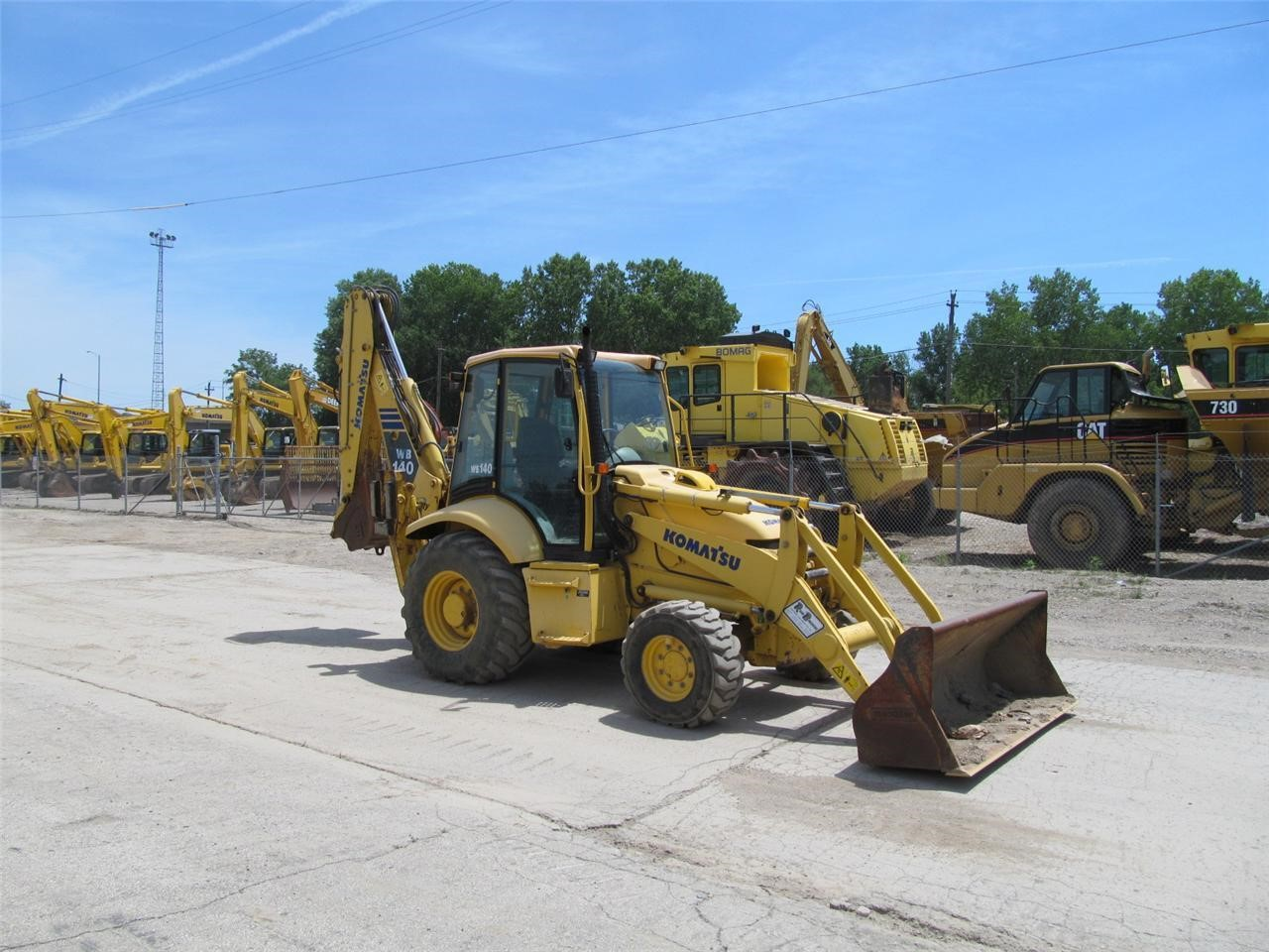 Detail photo of 2003 Komatsu WB140-2 from Construction Equipment Guide