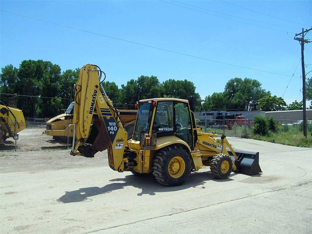 Detail photo of 2003 Komatsu WB140PS-2 from Construction Equipment Guide