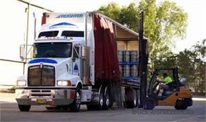 Kenworths T402 delivering for Mark Bloomer Transport