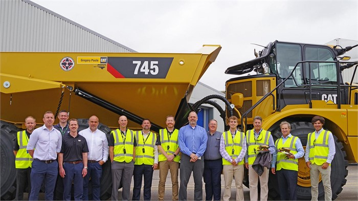 caterpillar hands off keys to its 50 000th articulated truck truck