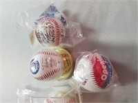 6 Autographed Baseballs.