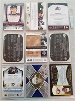 8 Rookie Cards and 1 dual Jersey Card.