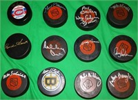 12 NHL HOCKEY PUCKS SIGNED BY MAURICE RICHARD,