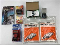 Multimeter, tire gauge, washers, bolts, adapter,
