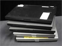 5 assorted laptops