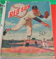 BINDER CONTAINING 20 RED SOX YEAR BOOKS FROM