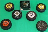 LOT OF 7 SIGNED HOCKEY PUCKS TO INCLUDE BRUIN'S