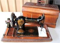 Hand Crank Family CS/Jones Sewing Machine #416587, w/Oak Case.