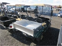 Green EZ Go Golf Cart