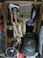 Box of paint brushes and knee pads