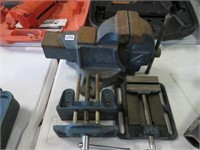 """4 """" bench vise and 2 small ones"""