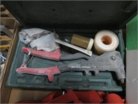 Box with remote starter, rivet gun and suspenders