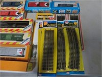 Group of Lionel HO train cars and track