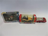2 toy trucks and motorcycle