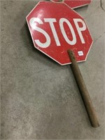 Two handheld stop signs 12 inches