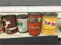 Eight assorted oil cans