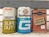 Three assorted oil cans