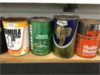 Seven assorted oil cans