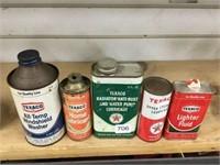 Five Texaco cans