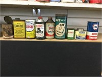 Nine assorted oil cans