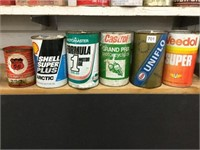 Six assorted oil cans