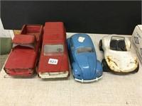 Four assorted Tonka toys