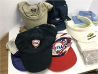 Group of assorted hats and shirts etc.