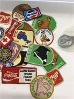 Group of assorted patches, bottle opener's etc.