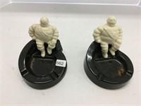 Two Michelin man ashtrays