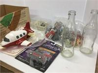 Box of assorted toys Coke bottles etc.