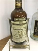 Four large whiskey bottles