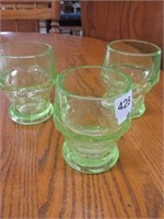 Group of green depression glassware