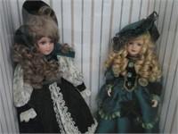 2 porcelain dolls & case