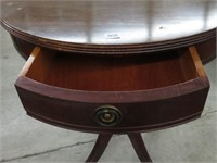 Pedestal drum top table with drawer