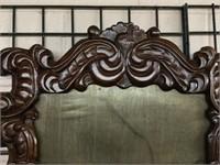 Ornate carved mirror frame