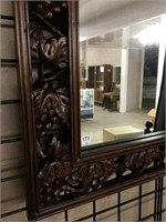 Ornate carved wall mirror