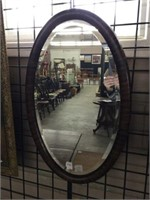 Framed beveled glass wall mirror