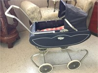 Antique doll buggy with dolls