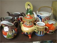Tray of Oriental teapots & cream and sugars