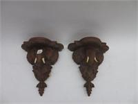 Pair of ornate elephant shelves