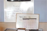 2 whiteboards, desktop calendar