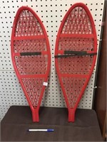 RED PLASTIC SNOW SHOES